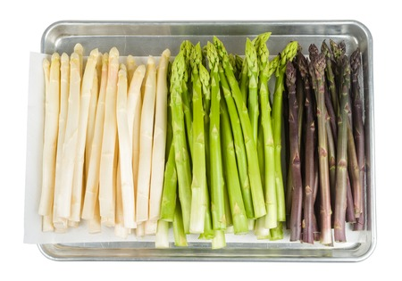 baking tray: Bunch of fresh white asparagus on baking tray isolated on white