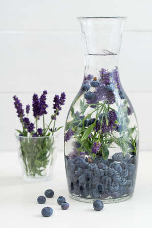 infused: Infused water with blueberries and lavender in a pitcher