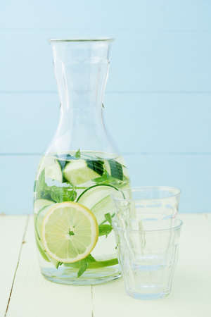 infused: Infused water with cucumber, lemons and mint in a pitcher Stock Photo