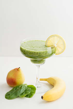 margarita glass: Healthy green smoothie made of pear, spinach and banana in a margarita glass Stock Photo