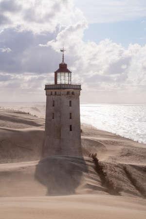 jutland: Sandstorm at the lighthouse Rubjerg Knude in North Jutland, Denmark