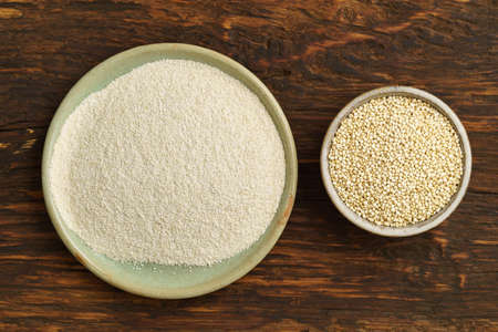 raw: Quinoa and quinoa flour in small bowls
