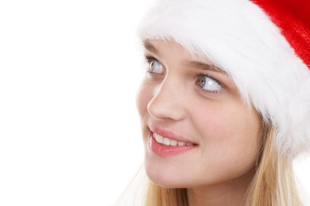 The beautiful girl in a christmas red cap photo