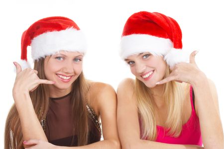 The beautiful girls in a christmas red caps  photo