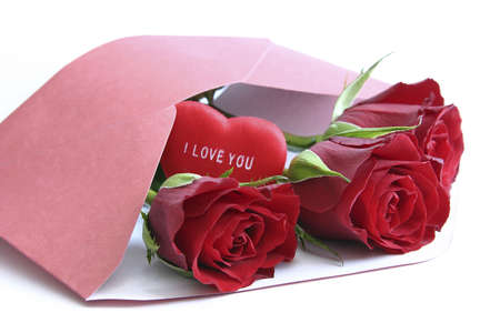red roses in envelope  - love messageand heart with message Stock Photo