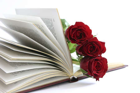 three red roses in open book Stock Photo