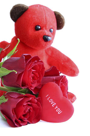 red teddy bear with roses and message on heart saying