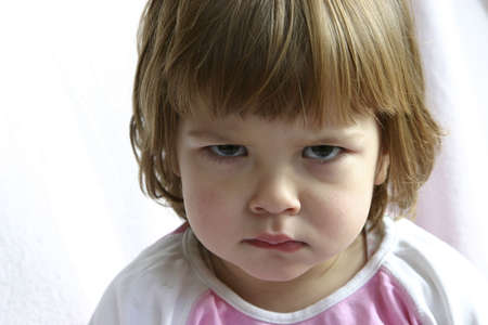 Little cute child, looking naughty. Stock Photo