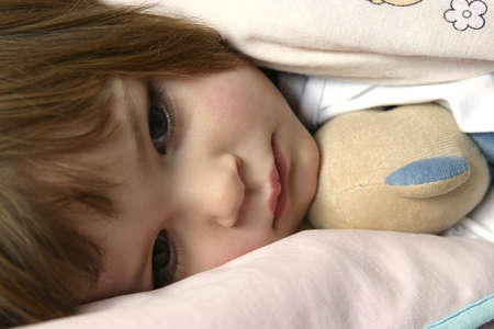 littl girl lying in bed just before falling asleep Stock Photo - 720797