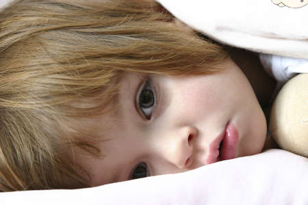 littl girl lying in bed just before falling asleep Stock Photo - 720798