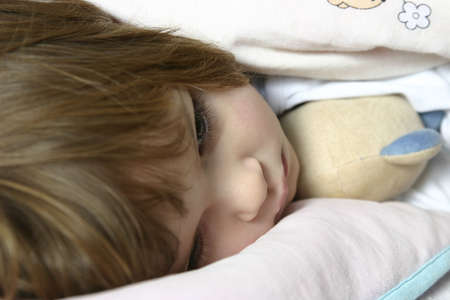 littl girl lying in bed just before falling asleep Stock Photo - 720766