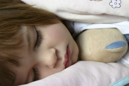 littl girl lying in bed just before falling asleep Stock Photo - 720767