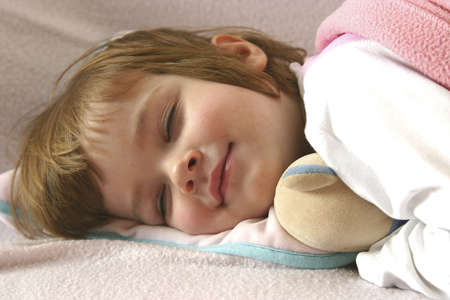 littl girl lying in bed just before falling asleep