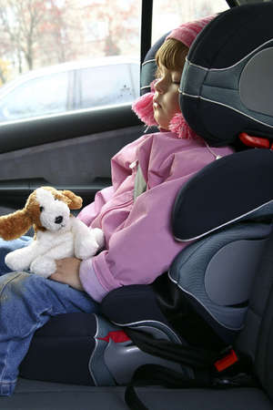 Child sleeping in a car. photo