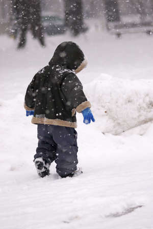 Boy in a snowstorm photo