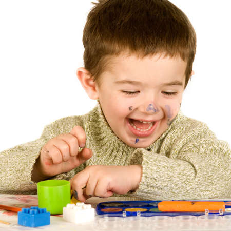 Beautiful young boy enjoying his game.  Stock Photo - 4444792