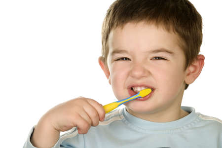 Young boy cleans a teeth photo