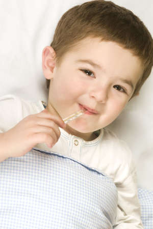 Child with flu and fever Stock Photo