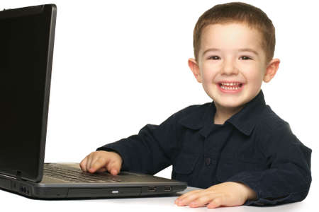 Jongen en Laptop Stockfoto