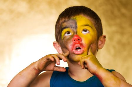 little boy and a cheerful make-up