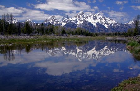 Teton Range reflected in a Snake River pond, Wyoming Stock Photo