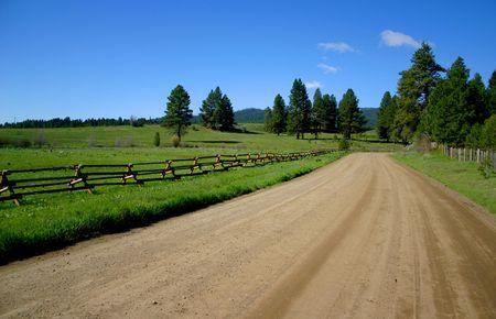 fenceline: Idaho, Country Road Stock Photo