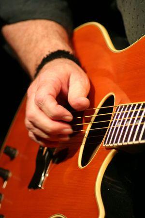 showman: Guitar Player Stock Photo