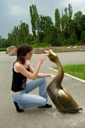 younglady: Young lady caress the goose. Stock Photo