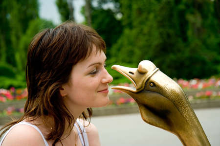 younglady: Young lady listens the goose.