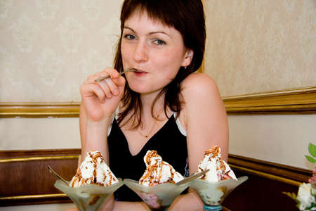 younglady: Brunette younglady dilemma: three ice creams and one teaspoon.