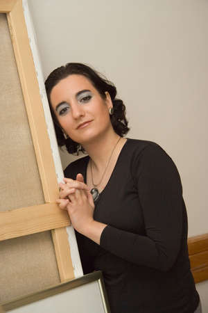 younglady: Lady painter in black. Painter woman.