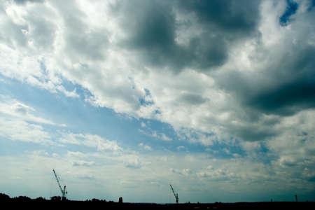 industrial landscape: La zona � industriale. Panorama industriale con cielo nuvoloso e gru