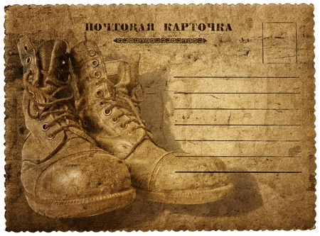 postcard with a picture of old shoes isolated on white