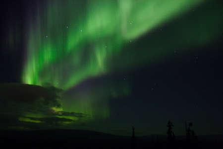 ionosphere: Aurora arc with clouds