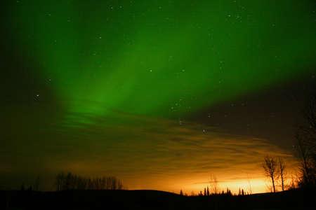 ionosphere: Aurora vs city lights Stock Photo