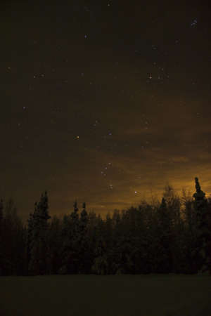 orion: Another well know star formation near horizon - Orion. Lights source is the town of Fairbanks - Aurora Capital of the World Stock Photo