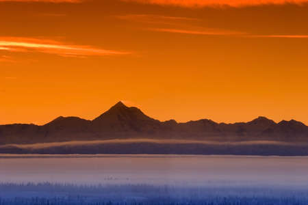 early fog: Early morning fog in the valley and skyline of the Alaska Range in Sunset