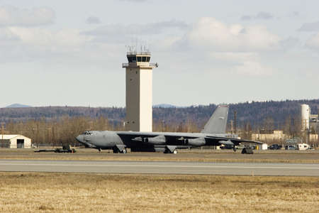 control tower: B52 stratofortress strategic bomber and a control tower of the air force base
