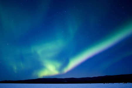 intrigue: Aurora over Birch Lake, Alaska, March 10, 2006