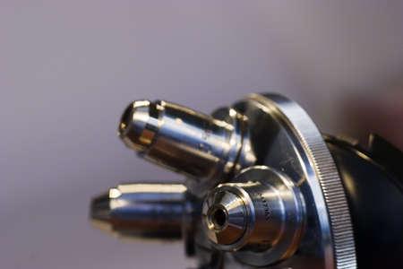 Revolver mounted microscope lenses photo