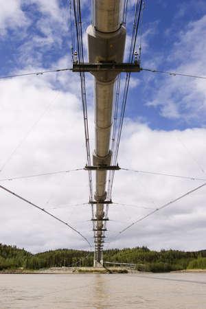 Transalaska Alyeska pipeline bridge crossing Tanana river near Delta Junction, AK photo