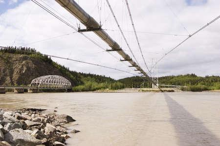 Transalaska oil pipeline and Richardson Hwy Bridges over Tanana river near Delta Junction, AK photo