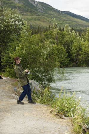 Fisherman pulling king salmon Stock Photo - 486129
