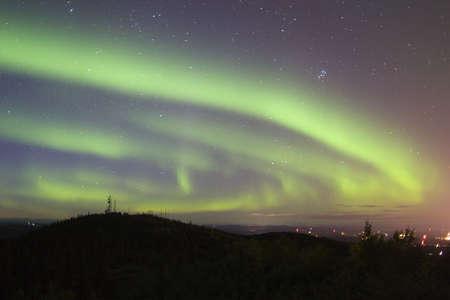 auroral: Aurora Borealis swirling over Fairbanks - the auroral capital of the wold