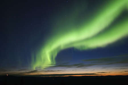 auroral: Twilight sky with green auroral arc