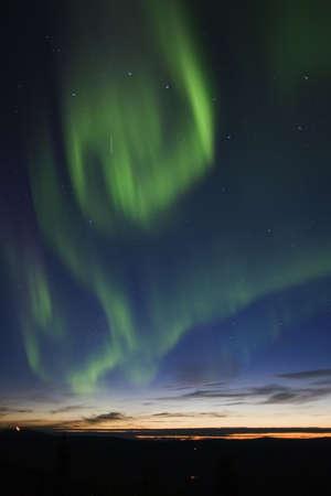 ionosphere: Aurora borealis swirls in the twilight sky
