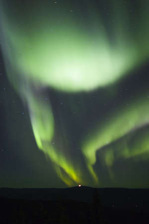 polaris: Two arcs of aurora borealis in nights sky