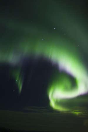 no cloud: Night sky, cloud over horizon, northern lights. Overhead shot, no ground visible Stock Photo