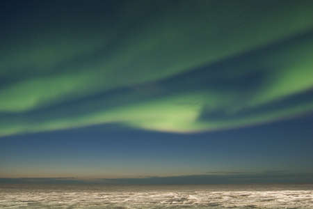 polaris: Swirling northern lights over arctic tundra