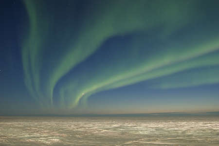 Arctic tundra and aurora borealis photo